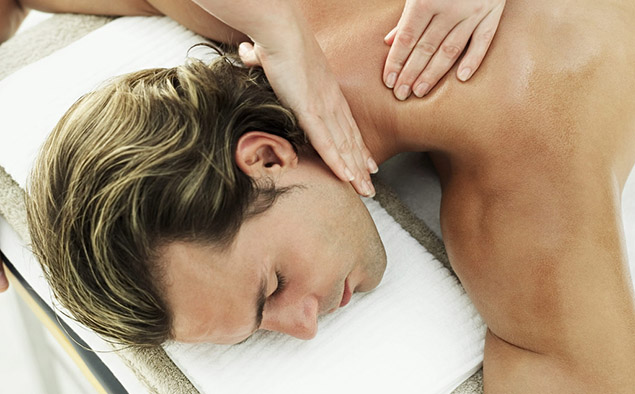 Young Man Getting a Massage --- Image by ゥ Royalty-Free/Corbis